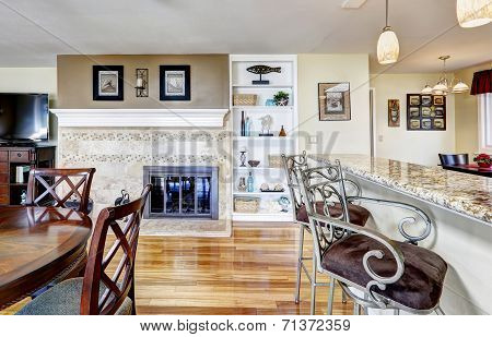 Kitchen With Fireplace And Dining Table