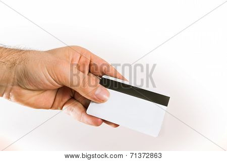 hand holding up a credit card
