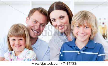 Portrait Of A Jolly Family Smiling At The Camera