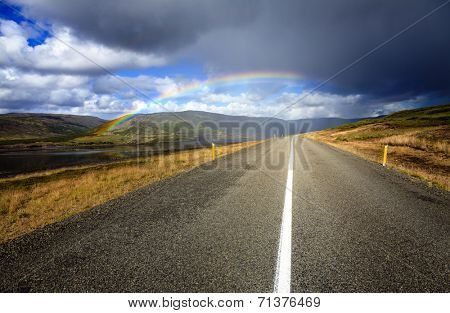 Rainbow road in Westfjords in Iceland