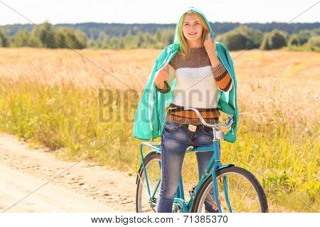 Attractive blonde girl during her cycling