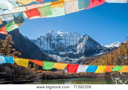 Pearl Lake with prayer flag and mt. Chenrezig in Yading national level reserve Daocheng Sichuan Province China. poster