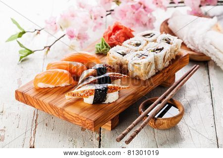Sushi Set: Sashimi And Sushi Rolls On Blue Background