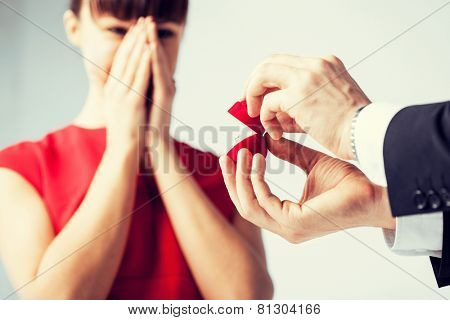 picture of couple with wedding ring and gift box