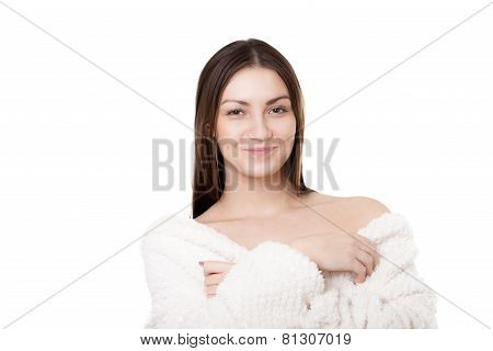 Portrait of smiling sexy young woman taking off white bathrobe undress exposing shoulders with provocative look isolated on white background poster