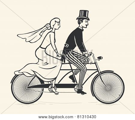Bride and groom riding a vintage tandem bicycle