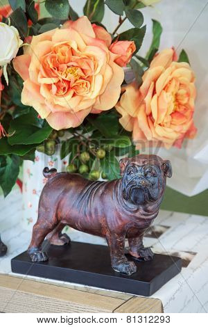 Dog A Figurine, Against Flowers