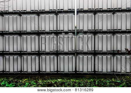 Stack of white chemical plastic container