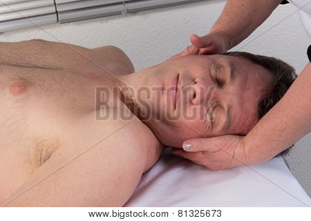 A Therapist Using Acupressure To Cure A Man