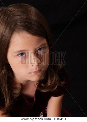 Brunette Little Girl on Black