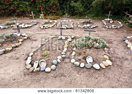CARMEL, USA - JUNE 7, 2011: cemetery of Carmel Mission with graves of indians decorated with shells