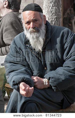 Jerusalem, Israel - March 15, 2006: Purim Carnival. Portrait Of A Tramp Begging.