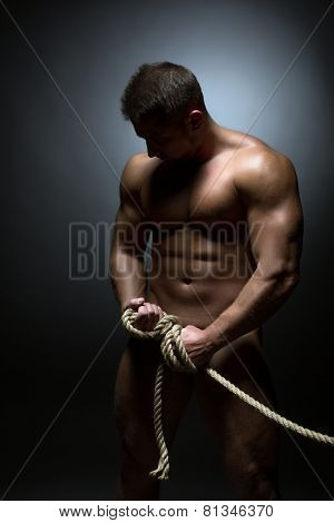 Naked man tied with rope. Concept of detention
