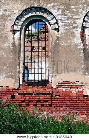The Old Ruinous Church Guarded Window And Sky
