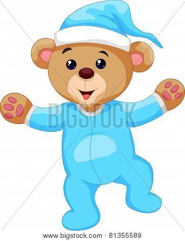 Cartoon teddy bear in blue pajamas
