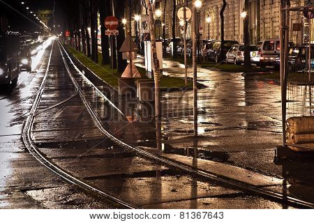 VIENNA, AUSTRIA -  DEC 4, 2012: wet trolley railes in the light and streets are reflecting light
