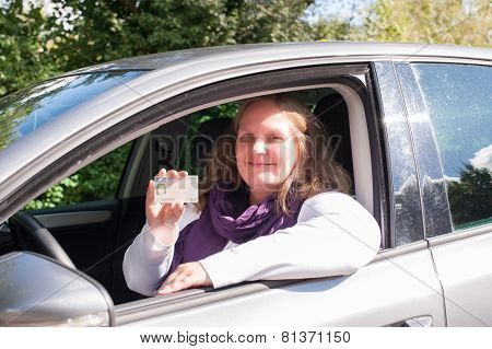 Woman and Driving license
