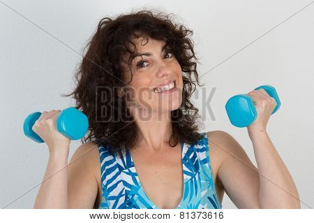 Woman Doing Sports With Dumbbell