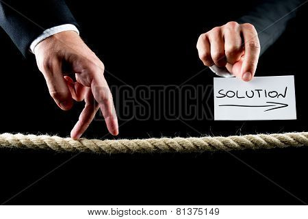 Male Hand Walking On Frayed Rope Towards Solution
