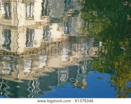 Reflection of apartment building in canal, Paris