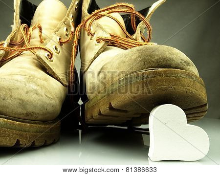 Heavy Military Boots Trampling Heart.