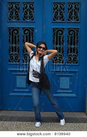 Girl Posing and Blue Door