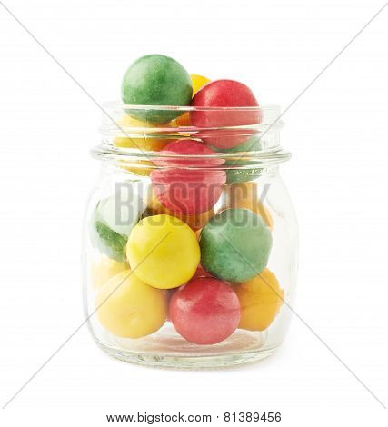 Multiple chewing gum balls in a glass jar isolated over the white background poster
