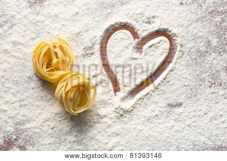 top view of heart and pasta