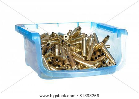 plastic container holding 7mm Magnum ammunition cartridge cases that have been cleaned , polished and had the primers removed ready for reloading