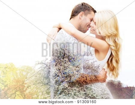 spring, love, romance, double exposure and dating concept - happy couple hugging over cherry blossom background