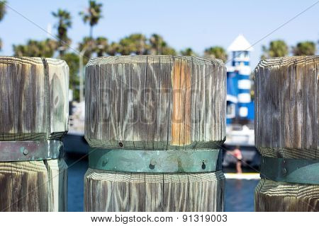 A close up of a wooden support post on a shoreline boardwalk in Redondo Beach California