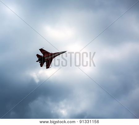 Russian Fighter Aircraft In Cloudy Sky