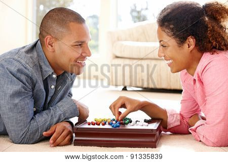 Mixed race couple playing solitaire