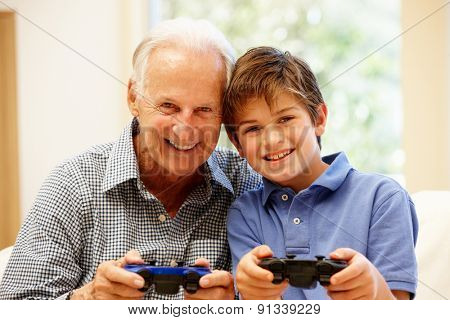 Grandfather and grandson playing computer games