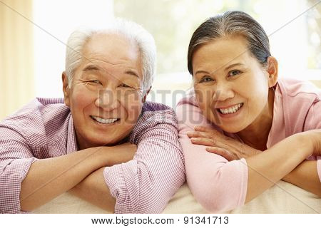 Senior Asian couple at home