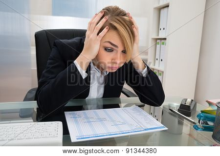 Businesswoman With Gantt Progress Chart At Desk
