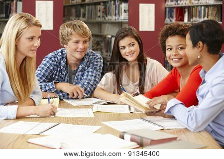 Group of students working together in library