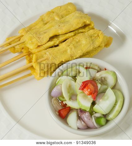 Grilled Pork Satay With Cucumber Salad On A Dish