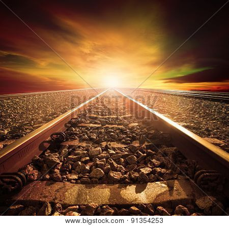 junction of railways track in trains station agains beautiful light of sun set sky use for land transport and logistic industry background backdropcopy space theme poster