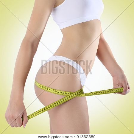 Woman With Tape For Diet On A Green Background