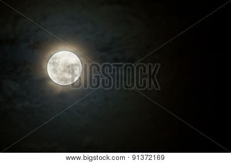 Scary Moon On Dark And Cloudy Night With Halo