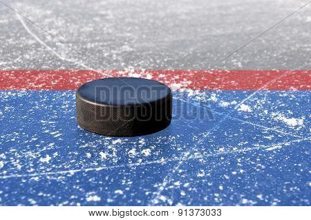 black hockey puck on ice rink poster
