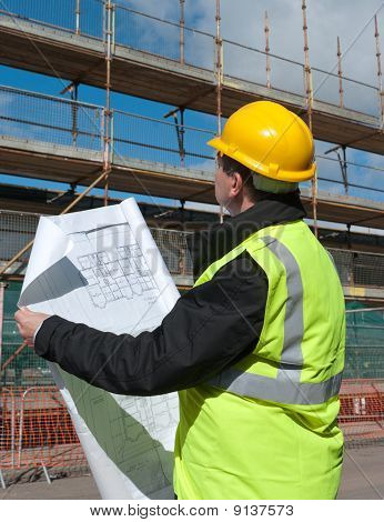 Builder Inspects Construction Site.