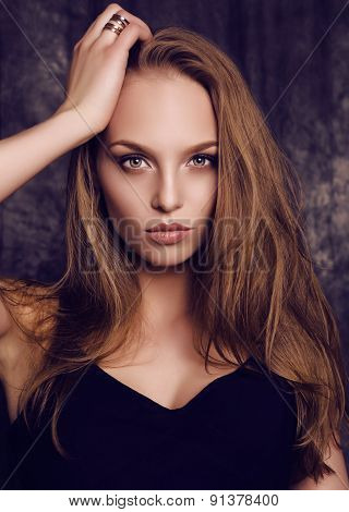fashion studio potrait of beautiful young woman with dark hair and green eyes poster