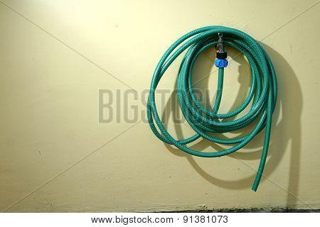 Green garden rubber hose