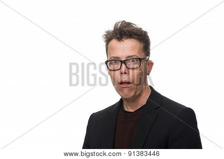 Shocked Businessman With Glasses Looking At Camera