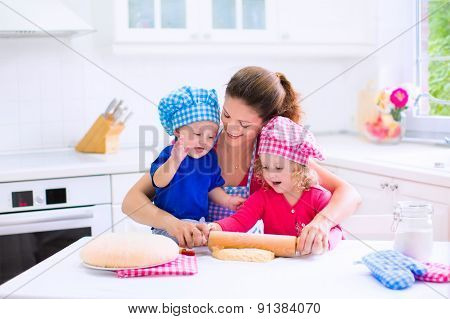 Kids Baking In A White Kitchen
