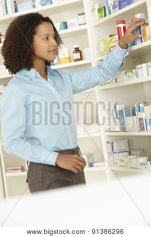 Female pharmacist working in UK pharmacy
