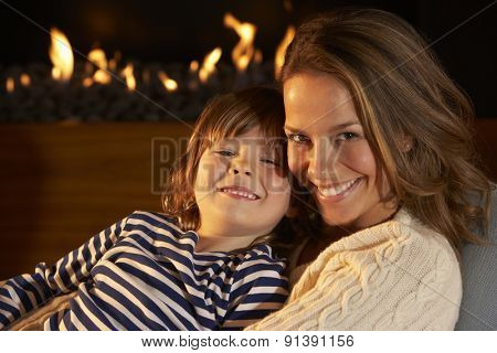 Portrait mother and son by firelight