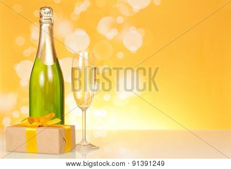 Bottle of champagne with glass